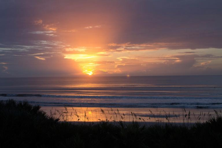 Watch the sunrise from your oceanfront balcony.