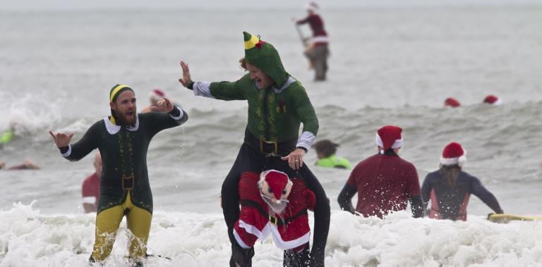 Surfing Santas in Cocoa Beach